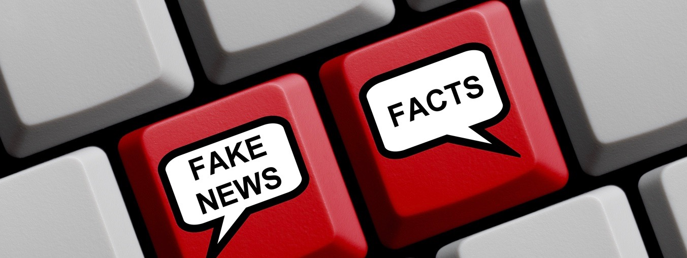 Red Computer Keyboard with balloons showing Fake News or Facts