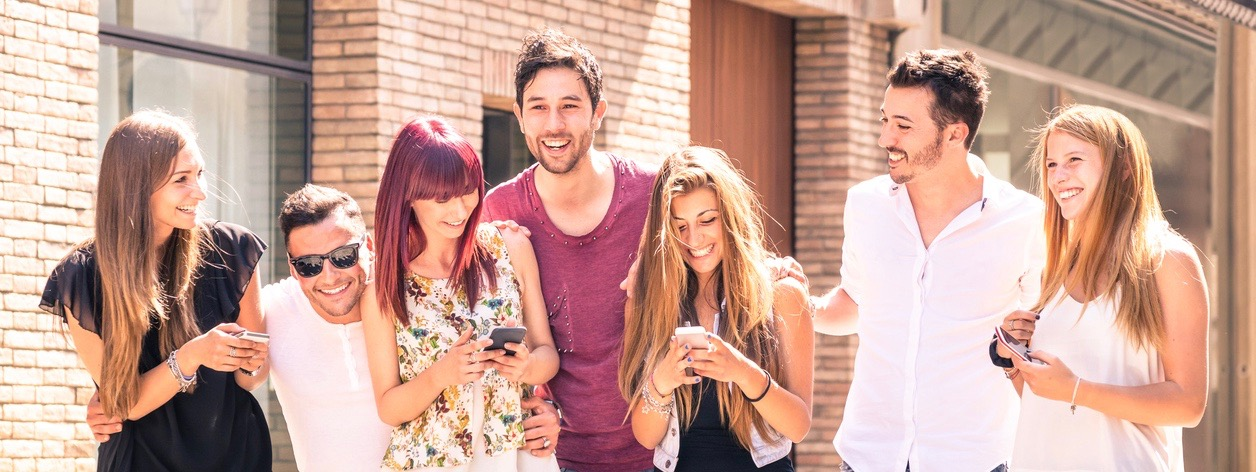 Group of young best friends having fun with mobile phone