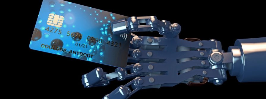 Robot hand holding a generic credit card