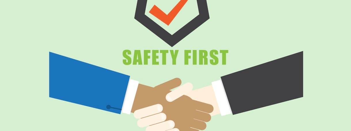 Technician handshake with safety first logo
